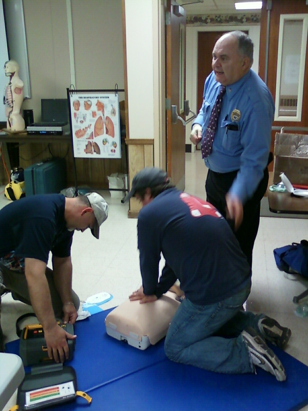 Fred instructing Leon and Jeremiah during AED practice.