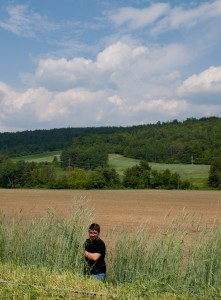 Keegan, Production Management Intern, in the rye field.